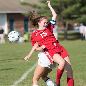 Shannon Harty gets tangled up with a Brunswick defender as she fights for the ball
